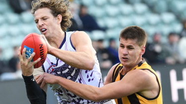 Fremantle captain Nat Fyfe and Hawthorn's Daniel Howe contest the ball in the round 17 clash in Launceston at the weekend.