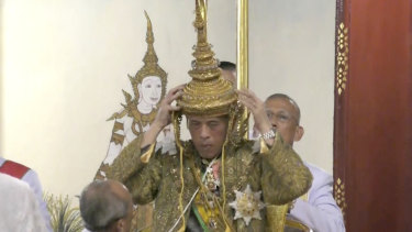 Thai King Maha Vajiralongkorn adjusts his crown at his coronation on Saturday.