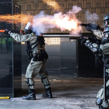 Riot police fire tear gas and rubber bullets as protesters attempt to leave the Hong Kong Poytechnic University on November 18.