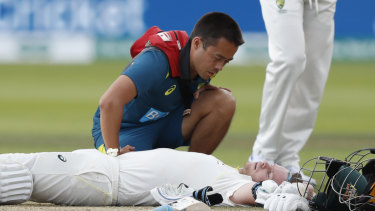 Steve Smith receives treatment after being hit on the side of the neck in day four of the second Ashes Test.