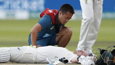 Australia's Steve Smith receives treatment after being hit on the side of the neck on day four of the second Ashes Test.