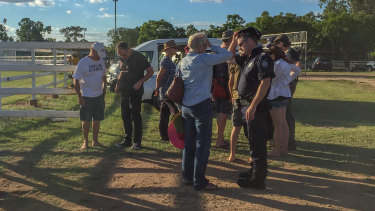 Police speaking to witnesses and convoy members after the incident.