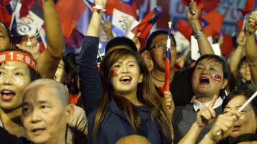 Supporters of the opposition nationalist KMT celebrate in Kaohsiung, Taiwan, on Saturday.