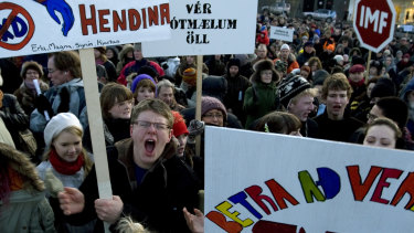 Demonstrators crowd into a city square in Reykjavik, Iceland in 2008, during a protest spurred by the country's economic collapse.