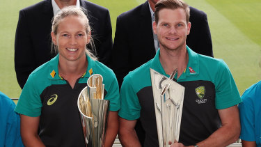 Australian cricketers Meg Lanning and Steve Smith with the women's and men's Twenty20 World Cup trophies.