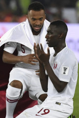 Qatar's Almoez Ali and Ahmed Fathi.