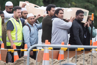 Mourners carry the coffin of Hussein  Moustafa after the Christchurch massacre.