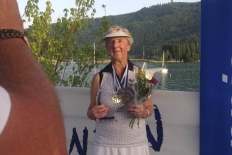 Shirley Whitaker holds her two senior champion trophies in Austria.