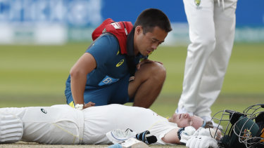 Steve Smith receives medical assistance after being hit in the neck by Jofra Archer. He left the field but returned to bat once Peter Siddle was dismissed.