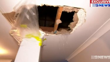 The hole caused by the man falling through the ceiling.