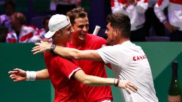 Captain Frank Dancevic embraces the winning doubles combination.