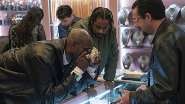 Kevin Garnett, Lakeith Stanfield and Adam Sandler in a scene from Uncut Gems.