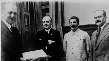 The conclusion of the Soviet-German Non-Aggression Treaty, known as the Molotov-Ribbentrop Pact, which later set scene for the invasion of Poland. From left to right: F. Gaus, Joachim von Ribbentrop, Josef Stalin, Viachislav Molotov on January 1, 1939.