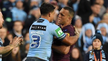 One last rivalry?: Latrell Mitchell and Will Chambers during last year's State of Origin series at ANZ Stadium.