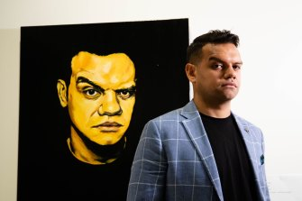 Meyne Wyatt with his self-portrait that won the Packing Room Prize at this year's Archibald Prize.