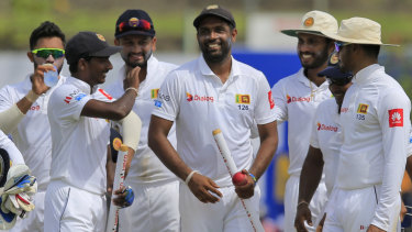 Spun out: Sri Lanka's Dilruwan Perera is congratulated by teammates after the defeat of South Africa.