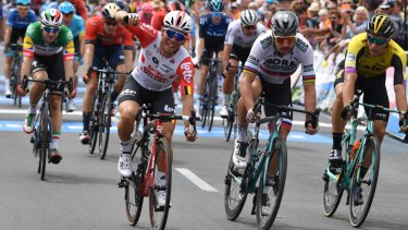 Premature celebration: Caleb Ewan crosses the line first at the end of stage five but was later disqualified.