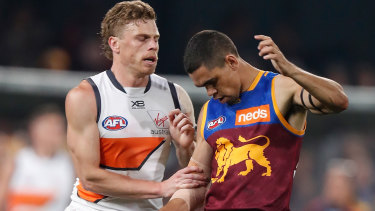 Cruel blow: Giants' Adam Kennedy makes contact with Charlie Cameron's injured elbow.