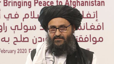 Mullah Abdul Ghani Baradar, the Taliban group's top political leader, speaks before signing a peace agreement between Taliban and US officials in Doha, Qatar, on Saturday.