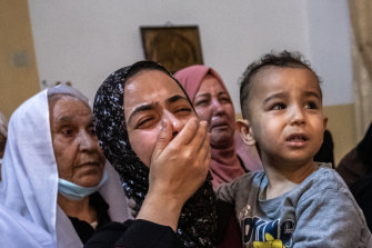 Relatives of Palestinian Ahmed al-Shenbari, who was killed during an Israeli raid in Beit Hanoun, Gaza Strip, mourn during his funeral on Tuesday.