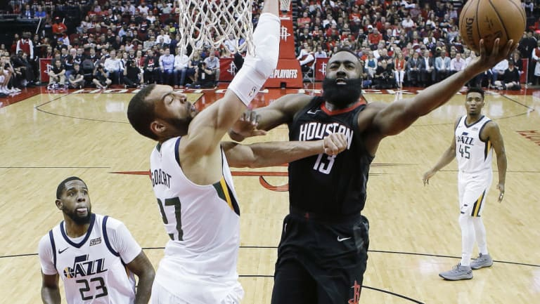 Houston Rockets guard James Harden drives to the basket past Utah Jazz centre Rudy Golbert.