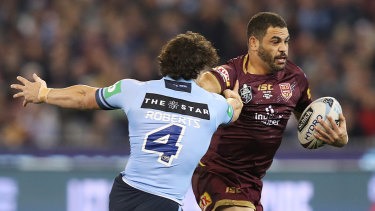 Greg Inglis attempting to discard James Roberts at the MCG.