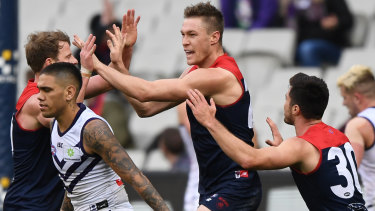 Demon Tom McDonald (centre) has worked his way back into form and booted three goals against the Dockers.