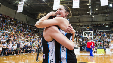 Canberra Capitals celebrate after winning the grand final.
