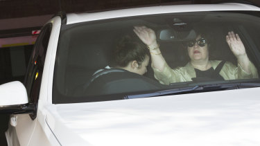 Ashleigh Howe, left, leaving her eastern suburbs apartment in a BMW with an unidentified woman last week.