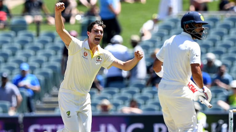 Australian bowler Pat Cummins reacts after dismissing Indian batsman Virat Kohli (right) for 3 runs.