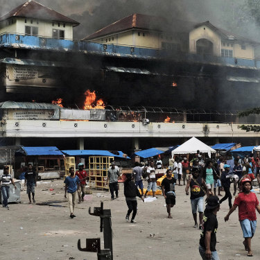 A market burns during a protest in Fakfak, Papua, on August 21.