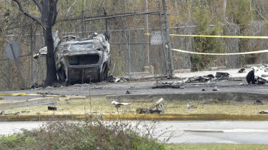 A view of a damaged vehicle near the site of the plane crash in Lafayette, Louisiana.