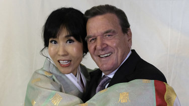 Former German Chancellor Gerhard Schroeder poses with his South Korean wife Kim So-yeon during a reception to celebrate their wedding in Berlin.