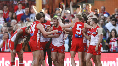 Kieren Jack celebrates after kicking a goal in his final match for the Swans.