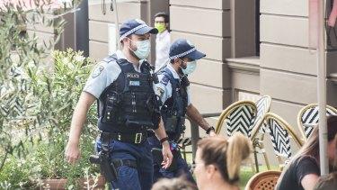 Police wearing masks in Sydney's CBD on Monday.