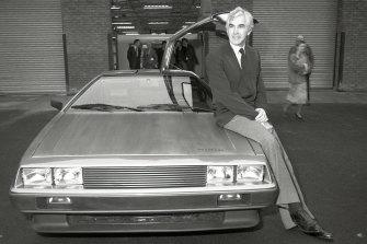 John DeLorean with a prototype of the first DeLorean car.