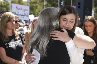 March organiser Janine Hendry embraces Brittany Higgins after her speech in Canberra.