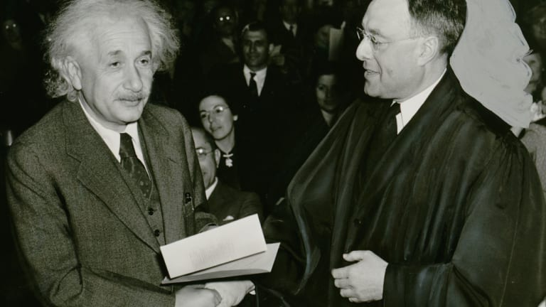 Albert Einstein receives  his certificate of American citizenship from Judge Phillip Forman in 1940.
