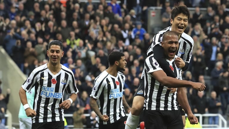 Delight: Newcastle United's Salomon Rondon (right) celebrates scoring his side's first goal against Bournemouth.