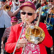Don Jordan leads the trombone troupe parading into Federation Square on Thursday afternoon,