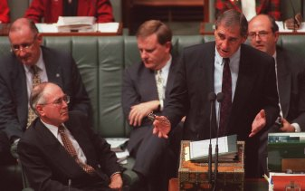 Then-Finance Minister John Fahey with Prime Minister John Howard in Federal Parliament in 1996.