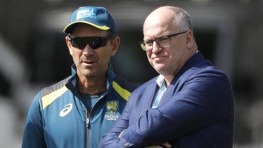 Justin Langer with Cricket Australia chairman Earl Eddings (right).
