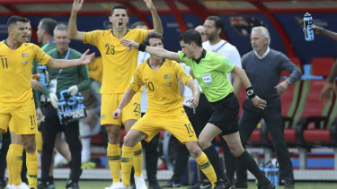 Spot fire: The Socceroos react after referee Andres Cunha consults VAR on the penalty.