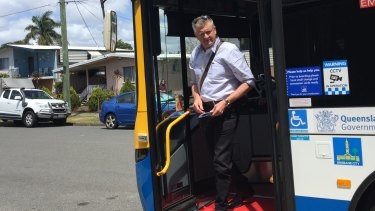 Mr Condren disembarks in Boondall after catching the bus from the city.