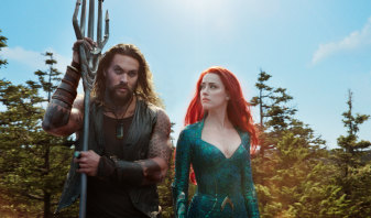 Jason Momoa as Arthur Curry/Aquaman and Amber Heard as Mera.