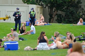 People enjoying the warm weather at St Kilda beach on Saturday.