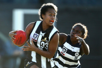 Catch me if you can: Vaomua Laloifi pictured playing for Collingwood in 2018.