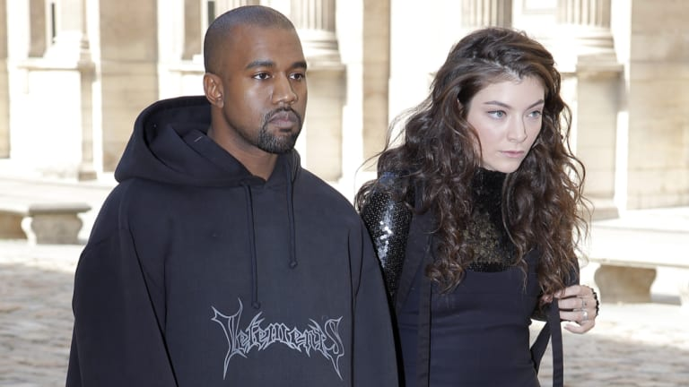 In happier times (although it might not look like it): Kanye West and Lorde at the Christian Dior's Paris Fashion Week show in 2015.