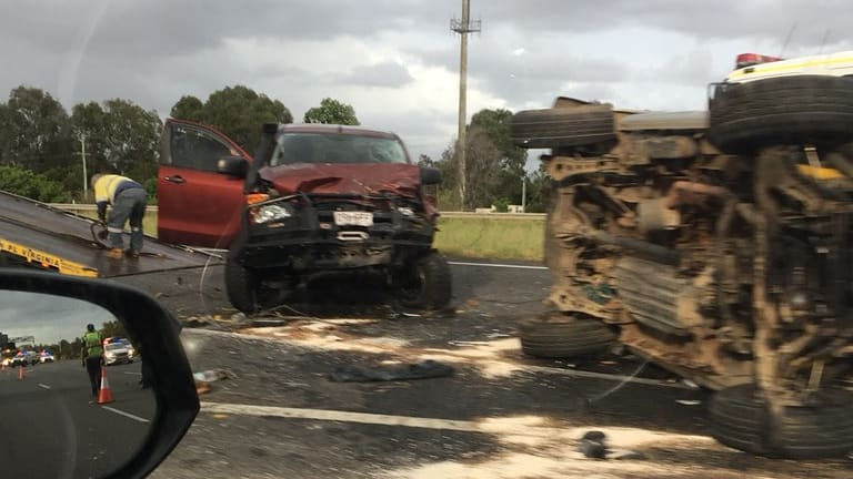The Bruce Highway was closed southbound after a two-vehicle smash at Bald Hills.