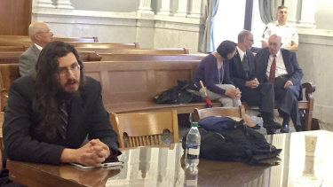 Michael Rotondo, left, in court during an eviction proceeding in Syracuse, New York, brought by his parents, Mark and Christina, of Camillus. The parents confer with their lawyer, Anthony Adorante, in the court gallery behind.